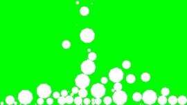 Falling Enneagons on a green background